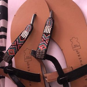 Brown sandals with tribal beading detail